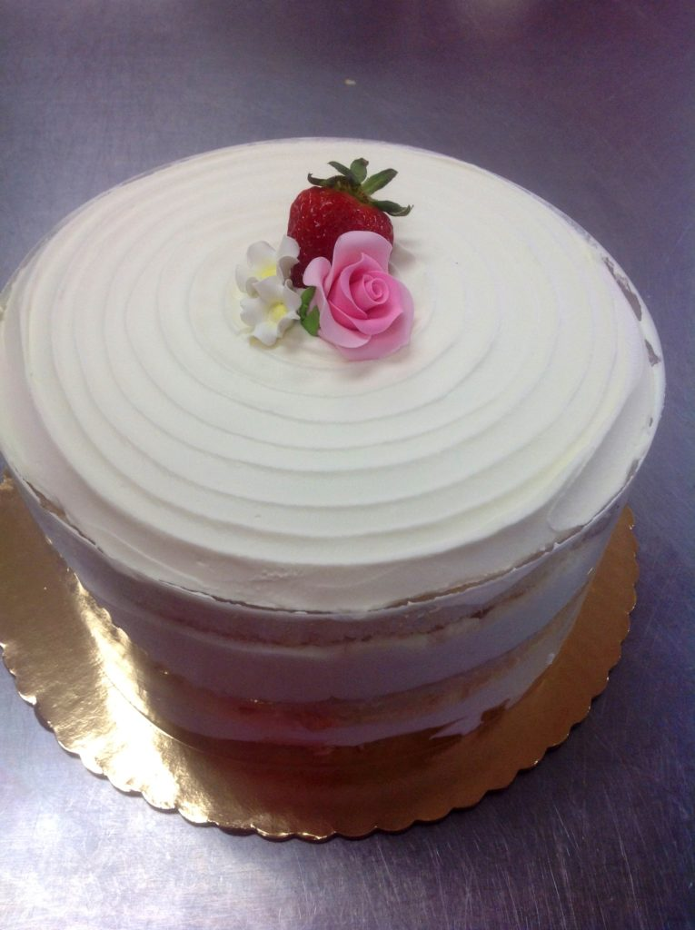 Vanilla Cake With Strawberries And Whipped Cream Frosting
