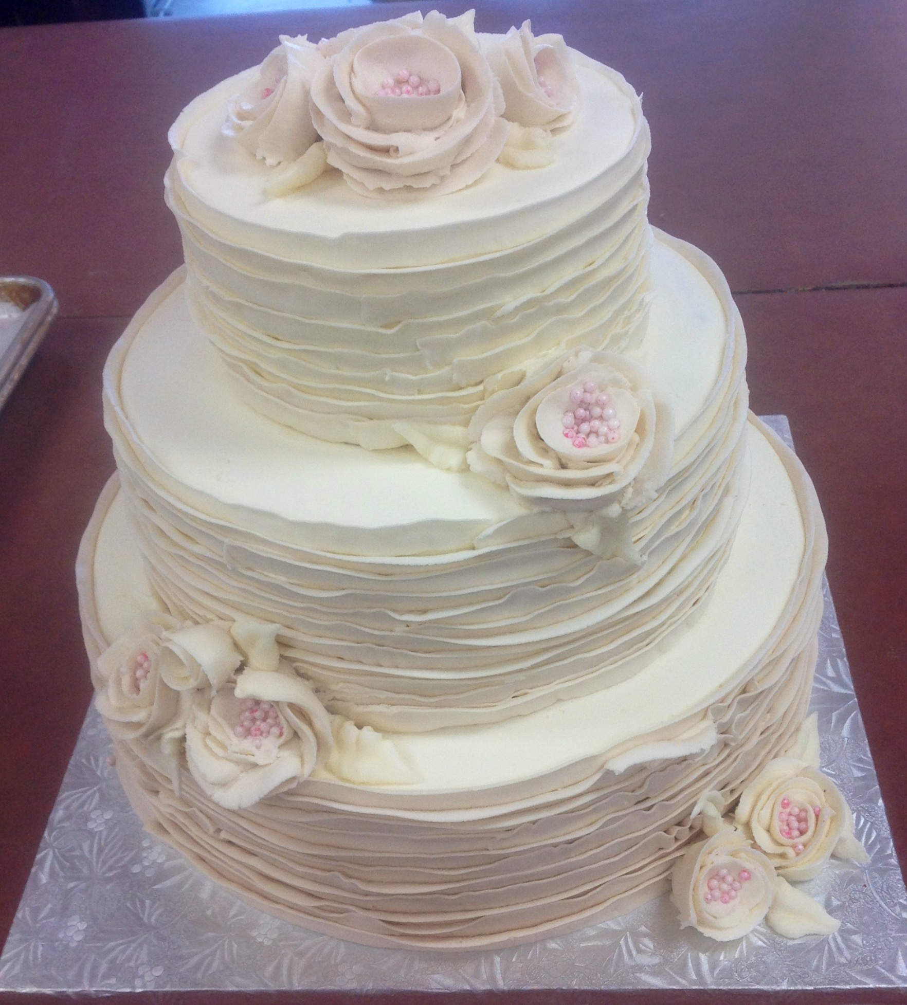 Tiered Rustic Wedding Cake with Buttercream Frosting and Flowers ...